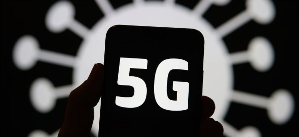 A 5G logo on a phone with a coronavirus illustration in the background.