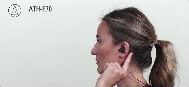 A woman wearing Audio Technica ATH-E70 In-Ear Monitors.
