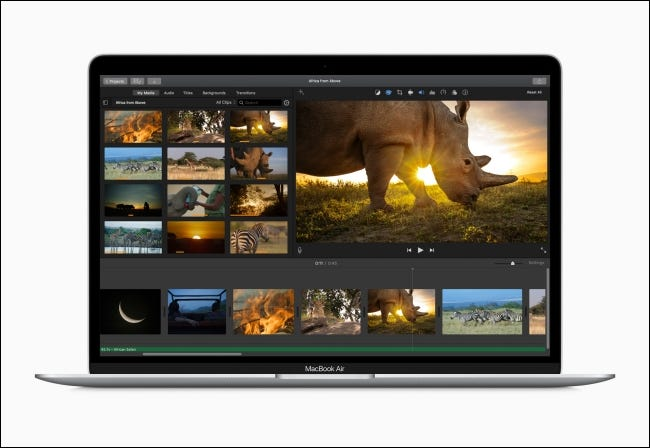A MacBook Air with video editor onscreen.