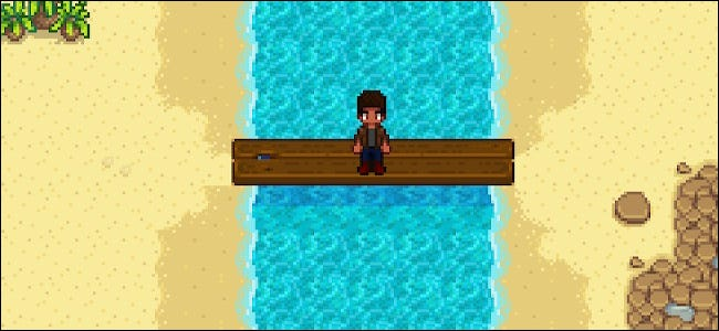 """A character sitting on a bridge at Tide Pool Beach in """"Stardew Valley."""""""