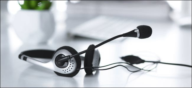 An audio headset with a built-in microphone, which can reduce background noise.