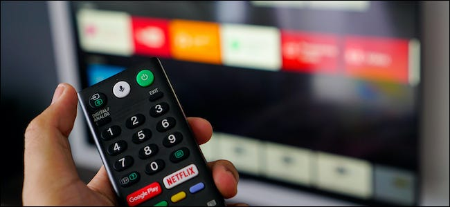 Someone holding an Android TV remote.