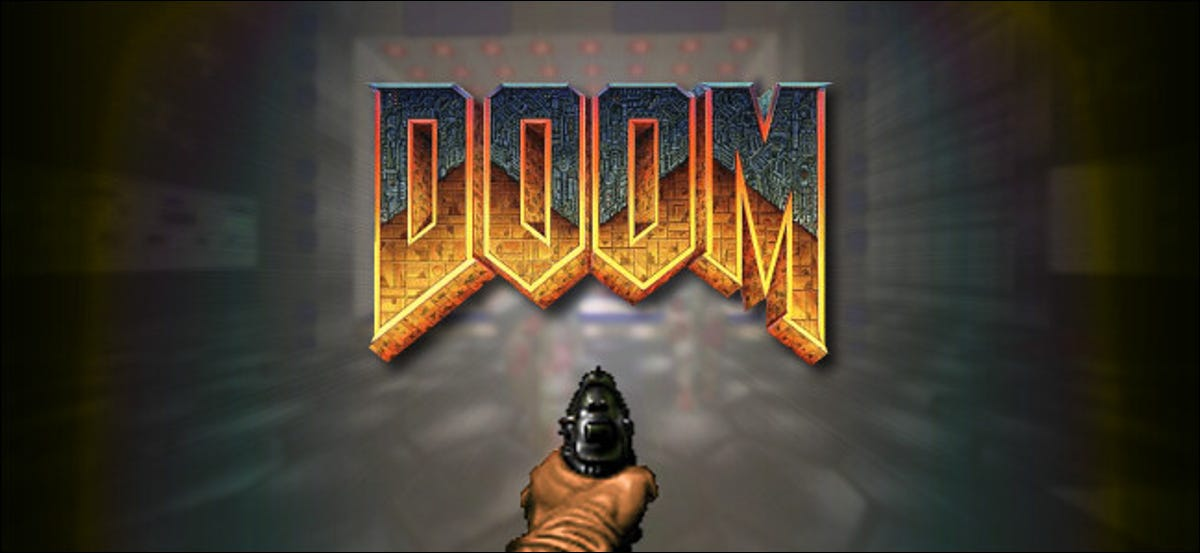 """The classic """"Doom"""" logo with a hand holding a gun."""
