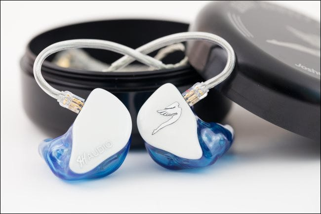 Custom in-ear monitor headphones for a musician.