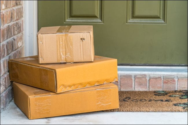 Three packages on a doorstep.