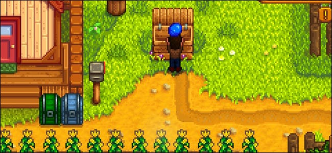 """A character loading a blueberry shipping box in """"Stardew Valley."""""""