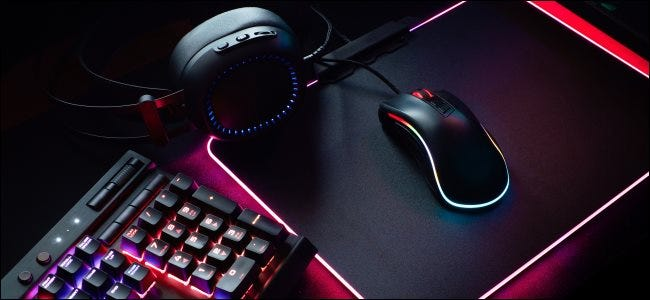 A gaming keyboard, mouse, and headphones.