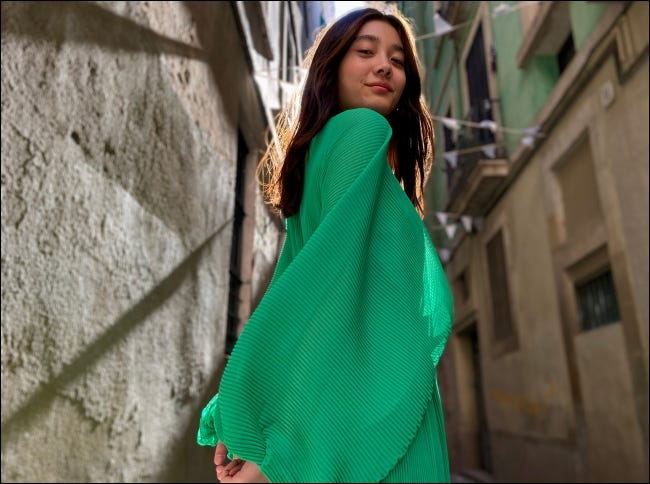 A girl in a green poncho.