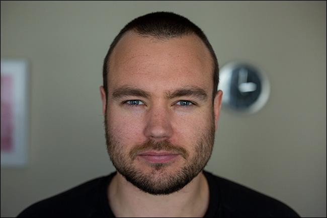 A photo of a man taken with a DSLR camera.