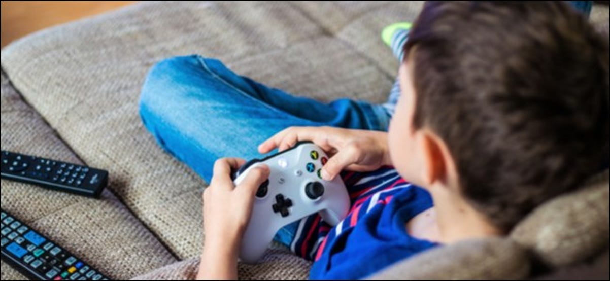 Child Holding Xbox One Controller