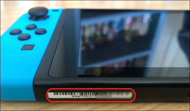A serial number on a Nintendo Switch.