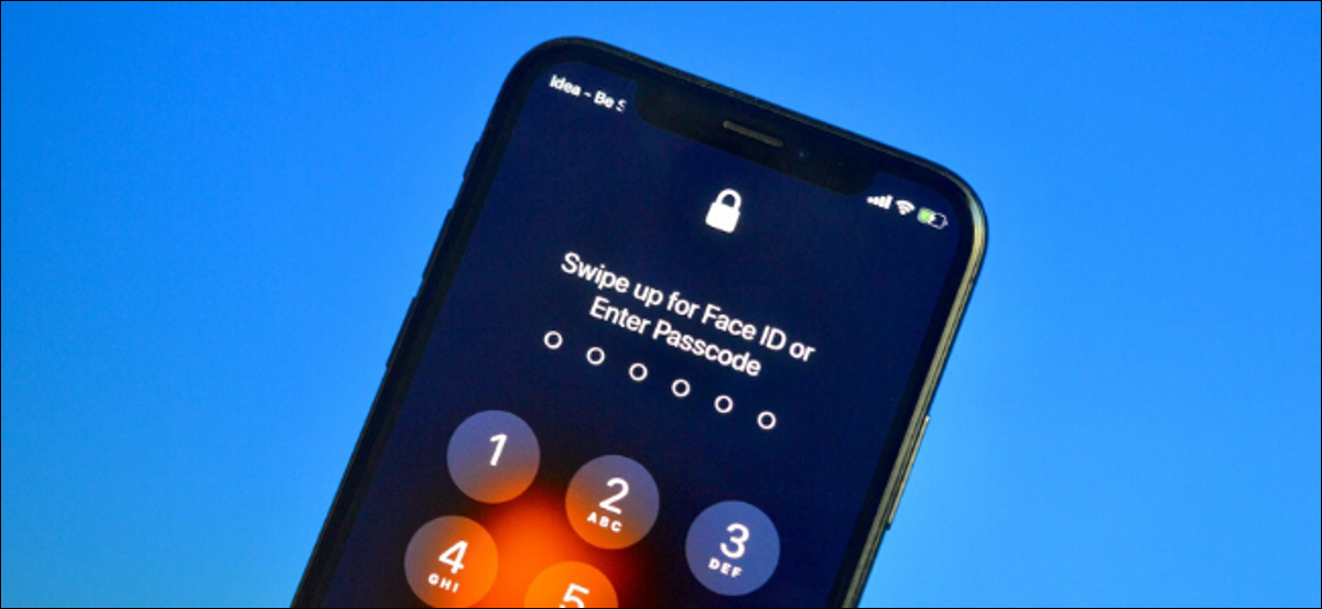 User unlocking iPhone with Passcode while wearing mask without Face ID