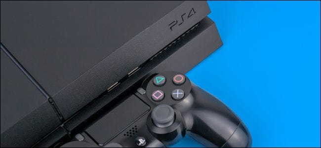 A Sony PlayStation 4 console with a DualShock 4 controller.
