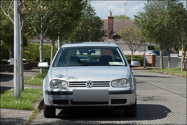 Front view of a Volkswagen vehicle taken with a telephoto lens.
