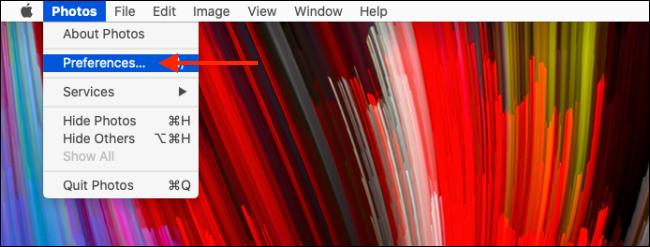 Haga clic en Preferencias de la aplicación Fotos en la barra de menú