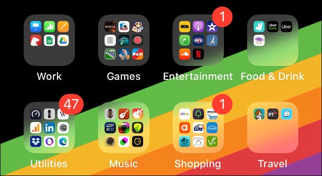 Folders of apps on an iOS Home screen organized by type.