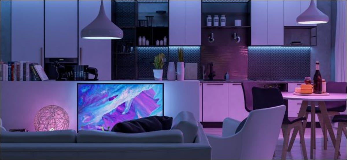A living room with purple LED lights.