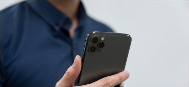 A man holding an iPhone 11.