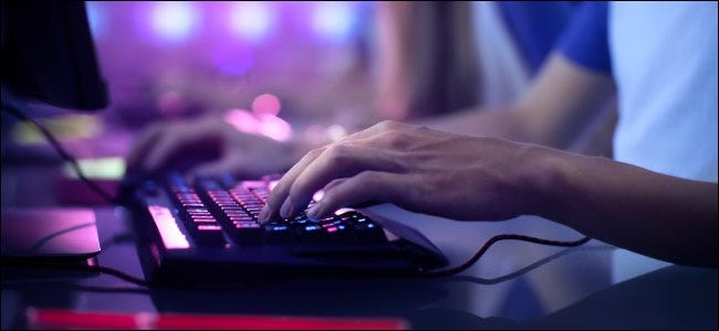 A hand on a gaming keyboard.