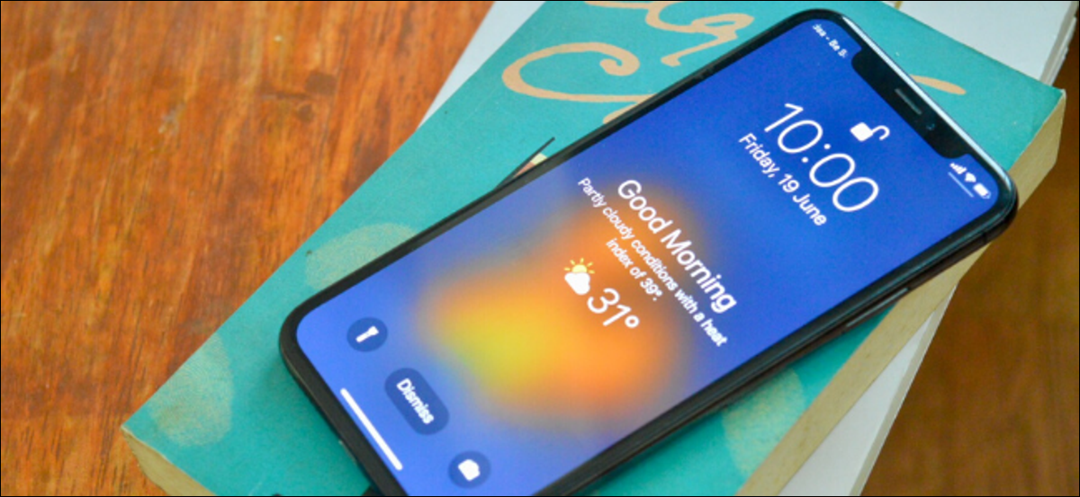 iPhone user viewing the weather on the lock screen