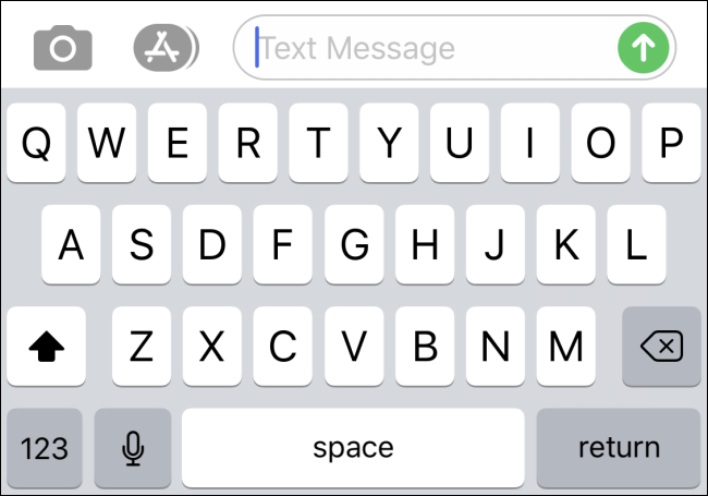 An iPhone on-screen keyboard with no Emoji button
