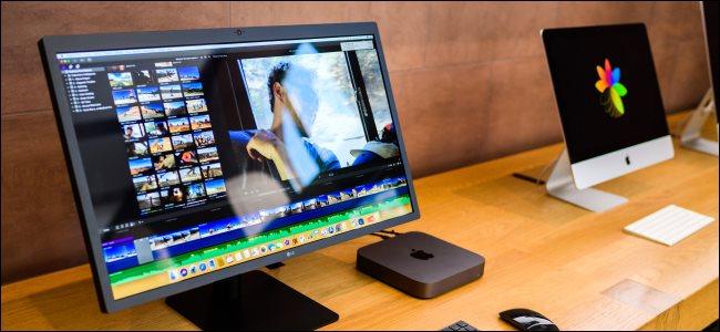 A Mac Mini next to an iMac.