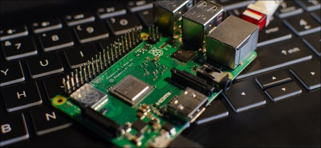 A Raspberry Pi sitting on a laptop keyboard.