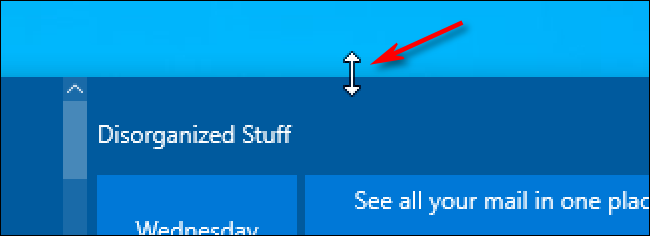 Uma seta de redimensionamento do cursor do mouse no Windows 10 sobre o menu Iniciar