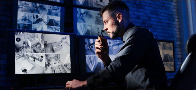 A security guard monitoring CCTV security cameras.