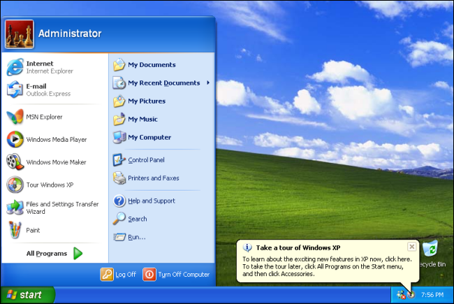 The Start menu on a Windows XP desktop with the green field and sky background.