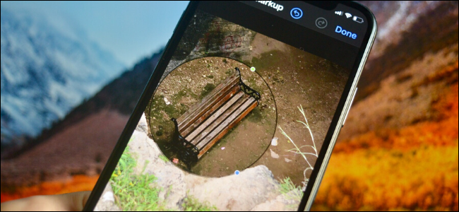iPhone user magnifying a part of the photo