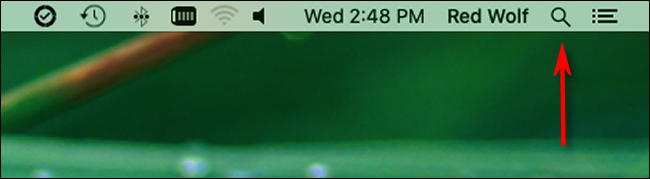 Click the magnifying glass icon in the menu bar to launch Spotlight Search.