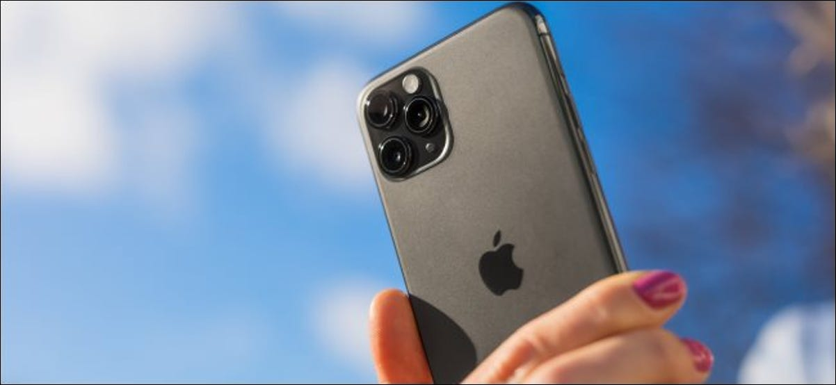 A woman holding an iPhone 11 Pro.