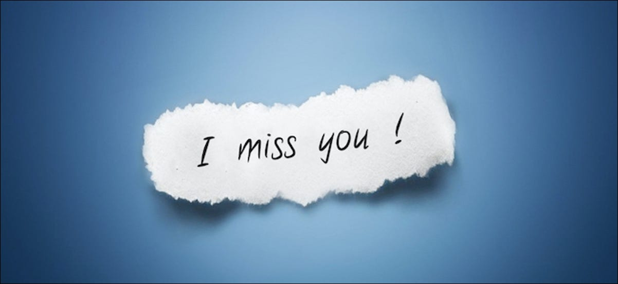 """I Miss You!"" written on a piece of paper"