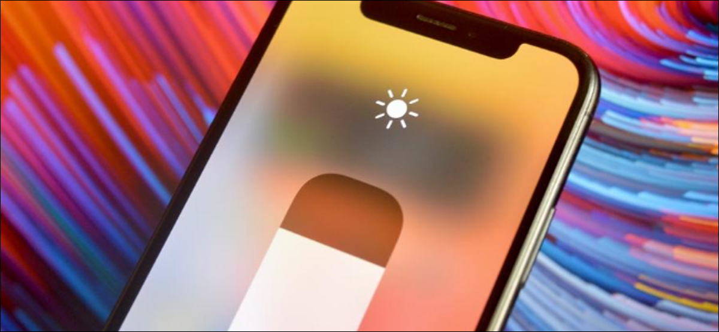 iPhone user adjusting brightness on their device
