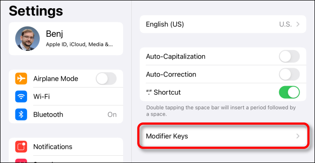 "Tap ""Modifier Keys"" in iPad Keyboard Settings."