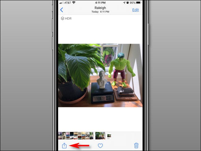 Tap the Share button in the Photos app.