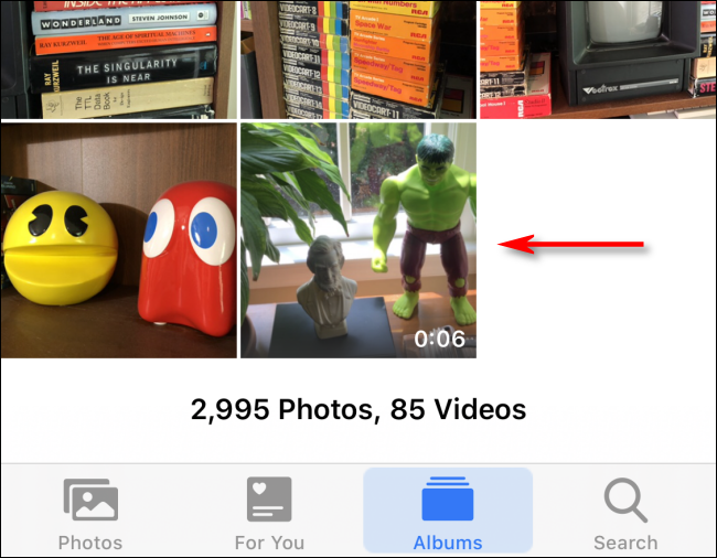 Tap a video in Photos to select it on iPhone