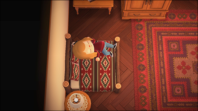 "A character sleeping in a bed in ""Animal Crossing: New Horizons."""
