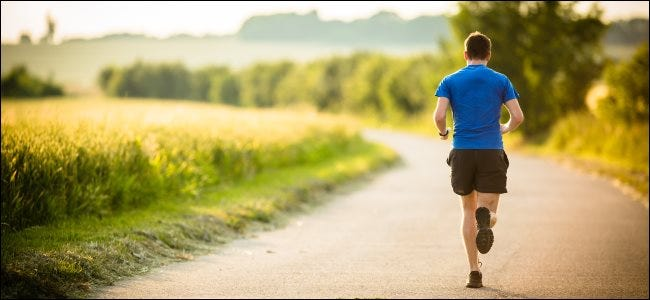 A jogger running on a road.