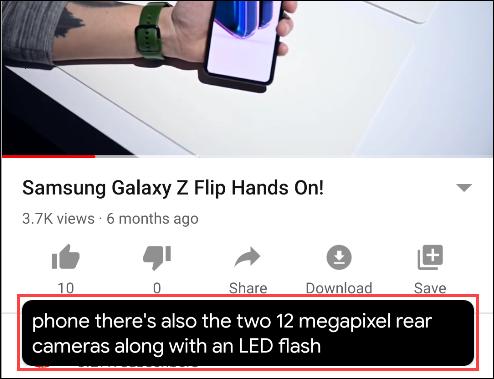 Un cuadro de texto Live Caption debajo de un video en YouTube.