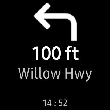 """An """"Awesome Navigator"""" direction on a Samsung smartwatch screen to turn left on """"Willow Hwy"""" in """"100 ft."""""""