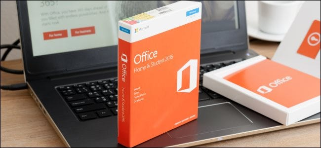 A boxed copy of Microsoft Office 2016 sitting on a laptop.