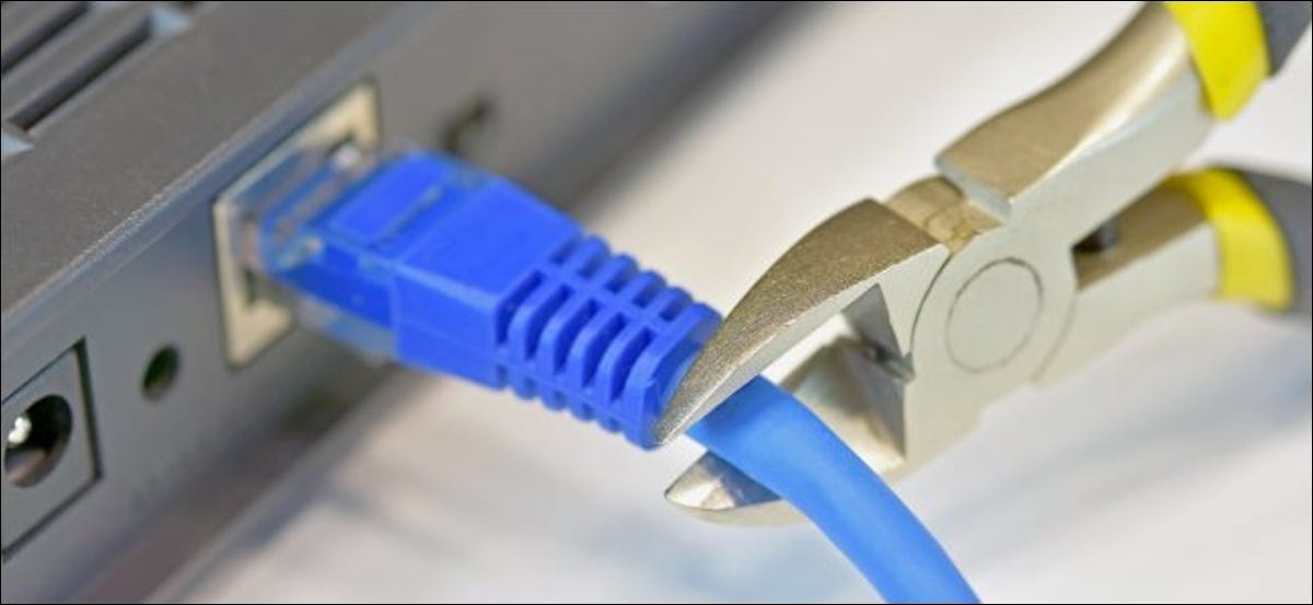 Physically cutting an Ethernet cable to a laptop.