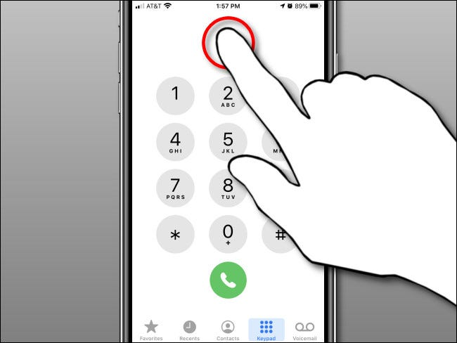 Tap and hold in the number display area, then release in the iPhone Phone app.