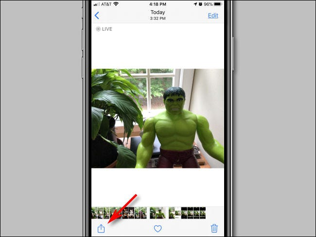 Tap the Share button in Photos on iPhone.