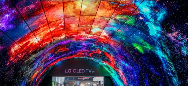 An overhead display of curved LG OLED TVs.