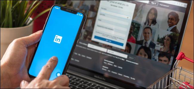 The LinkedIn app on a smartphone and the LinkedIn website on a MacBook.