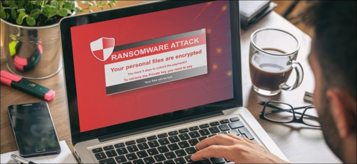 A MacBook with a ransomware attack on the screen.
