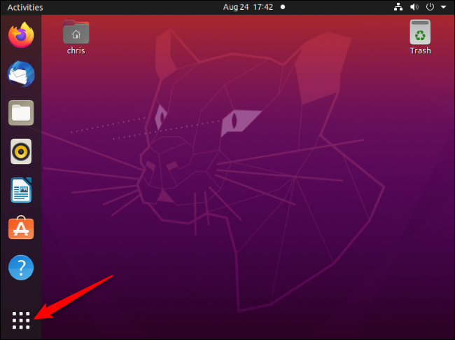 """The """"Show Applications"""" button at the bottom-left corner of a Ubuntu desktop."""